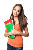 Sweet friendly young student. Sweet friendly young student girl holding colorful exercise books Royalty Free Stock Image