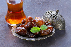 Sweet fruit dates for traditional tea Stock Photography