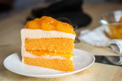 Sweet fruit dessert food , closeup fresh slice orange cake with Stock Images