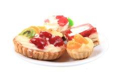 Sweet fruit desserts. Isolated on the white background royalty free stock image