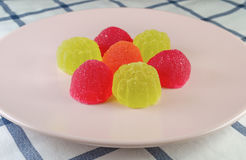 Sweet fruit jellies on plate Stock Photography