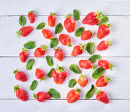 Sweet fruit mix of strawberry  and green mint leaves  on wintage Royalty Free Stock Photography