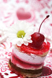 Sweet fruit red cake with cherry  and camomile Royalty Free Stock Photography