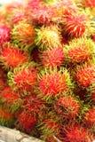 Sweet fruits rambutan in the market Stock Images