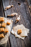 Sweet fudges with sesame on baking paper Royalty Free Stock Photo