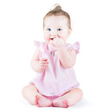 Sweet funny baby girl in a pink dress Royalty Free Stock Image