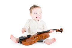 Sweet funny baby playing violin stock photos