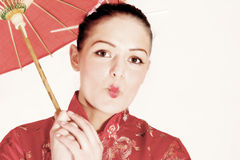 Sweet geisha. Young woman dressed like a chinese geisha royalty free stock photography