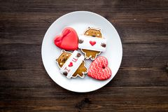 Free Sweet Gift For St Valentine`s Day. Heart Shaped Gingerbread On Dark Wooden Background Top View Copy Space Stock Image - 109758291