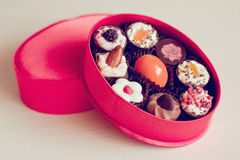 Sweet gift. Little pink box with a set of sweets royalty free stock image