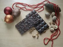 Sweet gift for the New Year. Christmas decorations. Chocolate with walnuts. Royalty Free Stock Photography