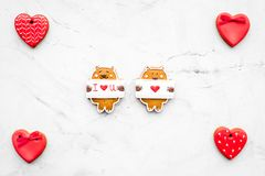Sweet gift for St Valentine`s Day. Heart shaped gingerbread on light grey background top view copy space stock photo