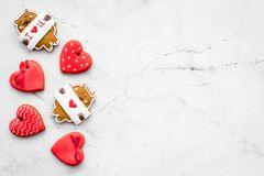 Sweet gift for St Valentine`s Day. Heart shaped gingerbread on light grey background top view copy space. Sweet gift for St Valentine`s Day. Heart shaped Stock Images