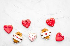 Sweet gift for St Valentine`s Day. Heart shaped gingerbread on light grey background top view copy space. Sweet gift for St Valentine`s Day. Heart shaped Royalty Free Stock Photos