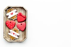 Sweet gift on Valentine`s Day. Heart shaped cookies and bear with lettering I love you on white background top view copy Stock Image