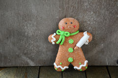 Sweet gingerbread man on the wooden boards Stock Photo