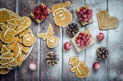 Christmas concept with gingerbread, gifts and snow. Royalty Free Stock Images