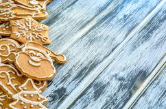 Christmas background with gingerbread. Sweet gingerbreads on a wooden table stock image