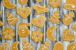 Christmas background with gingerbread. Sweet gingerbreads on a wooden table royalty free stock images