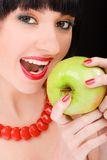 Sweet girl with apple stock images
