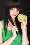 Sweet girl with apple Stock Photography