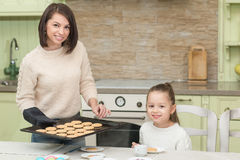 Sweet girl baking cookies with her mother Stock Image