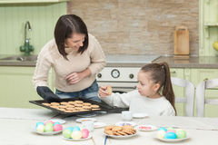 Sweet girl baking cookies with her mother Royalty Free Stock Image