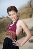 Sweet girl at the beach 2. Sweet oriental girl in a ethnic dress smiling Royalty Free Stock Photography