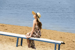 Sweet girl on beach with hat Stock Image