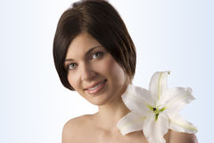 Sweet girl with big lily Royalty Free Stock Image