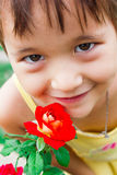 Sweet girl breathes fragrance of a rose Stock Photos