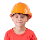 Sweet girl in a building helmet. On white background Stock Photos