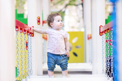 Sweet girl climbing on a playground Stock Photos