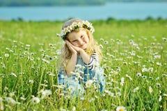 Sweet girl in daisy field Royalty Free Stock Photos