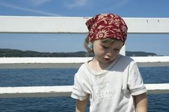 Sweet girl on a dock Stock Photos