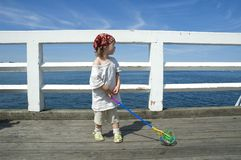 Sweet girl on a dock Stock Images