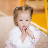 Sweet girl with Down syndrome. Sweet little girl with Down syndrome Stock Image
