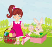 Sweet girl and  Easter Bunny Stock Photos