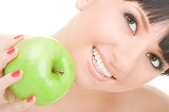 Sweet girl eating green apple Royalty Free Stock Image