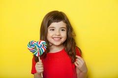Sweet girl enjoying lollipop Royalty Free Stock Photography