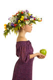 Sweet girl with flowers and an apple Stock Image