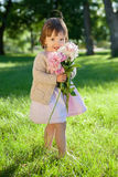 Sweet girl with flowers bunch in hands Royalty Free Stock Images