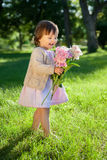 Sweet girl with flowers bunch in hands Royalty Free Stock Image