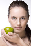 Sweet girl with green apple Royalty Free Stock Photography
