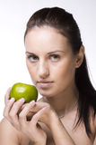 Sweet girl with green apple Royalty Free Stock Photo