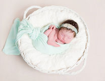 Sweet girl in a hairband napping, topview Royalty Free Stock Photos