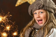 Sweet girl having fun with fireworks. Stock Photos