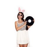 Sweet girl having fun with musical plate on white background Stock Photo