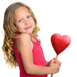 Sweet girl holding red heart. Stock Photos