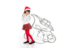 Sweet girl holding santa presents sack Royalty Free Stock Photos